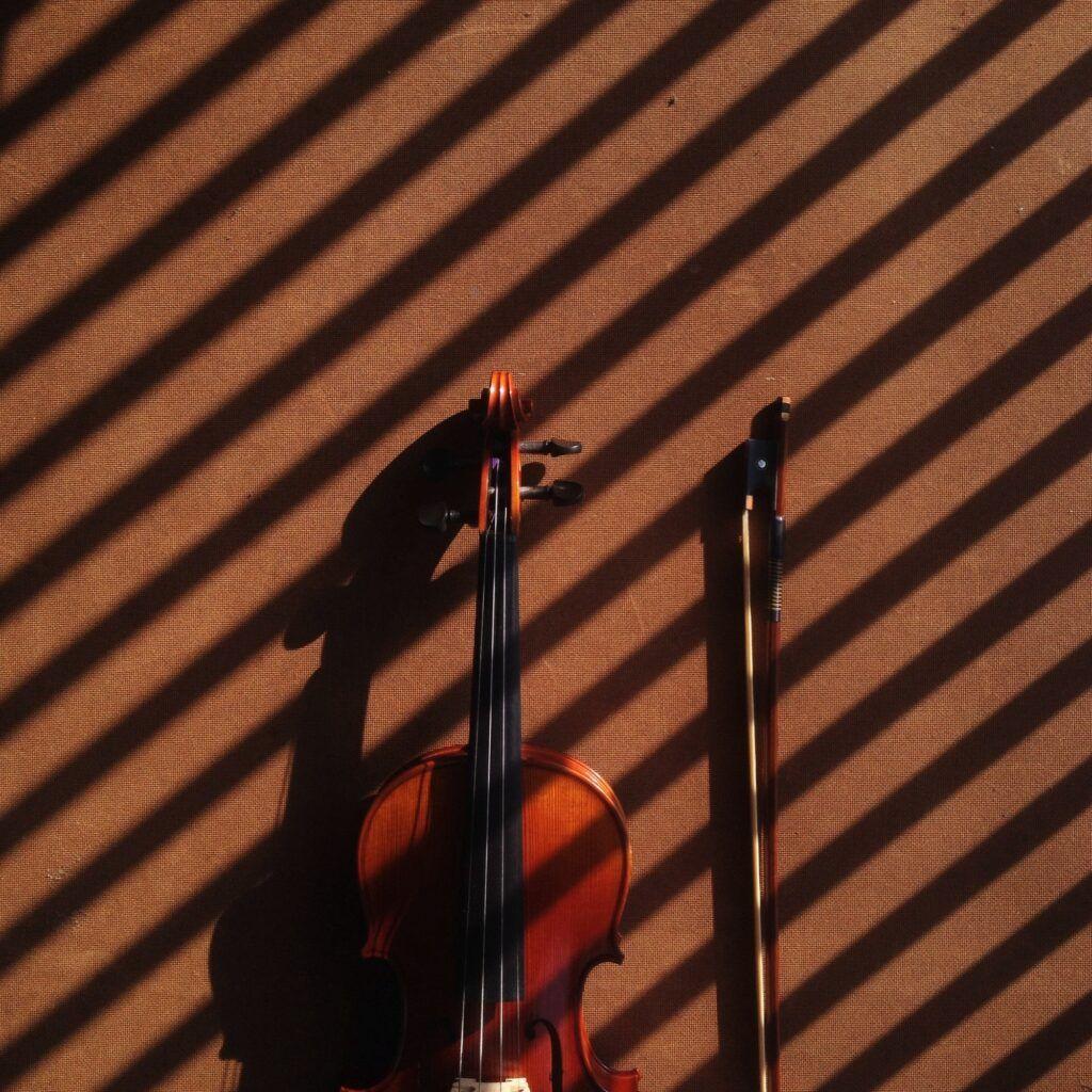 Music instrument violin on brown background shadow